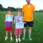ELLA O'CONNOR & JACK TANNER RECEIVE MOST IMPROVED ATHLETE CERTIFICATES FROM LITTLE ATHLETICS COACH KEVIN HAYES
